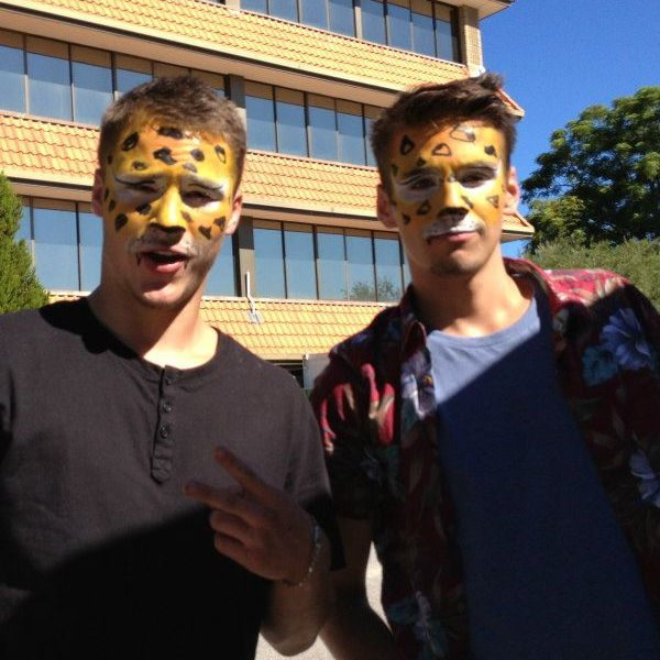 Urban artists with face paint like tigers